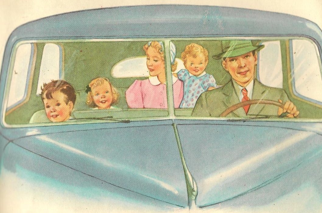 A father and son sit in the front of a car. A mother, daughter, and young child sit in the back.