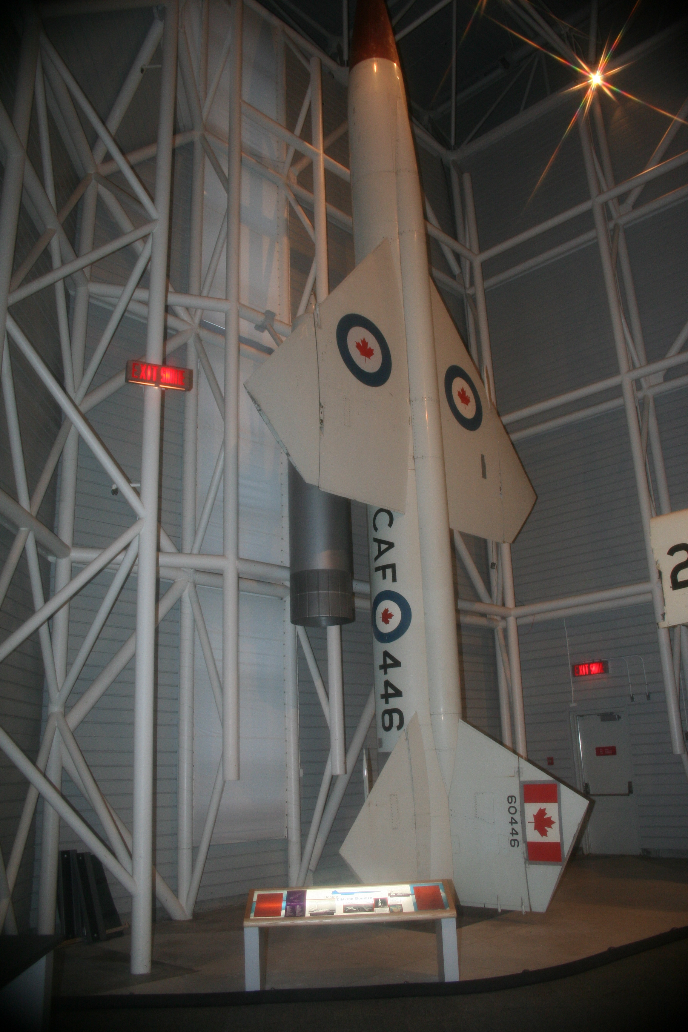 A missile with maple leaves surrounded by blue rings stands upright.