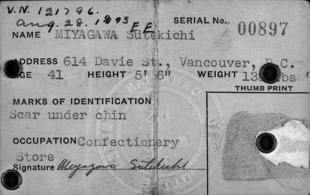 Internment identification card. Long description available.