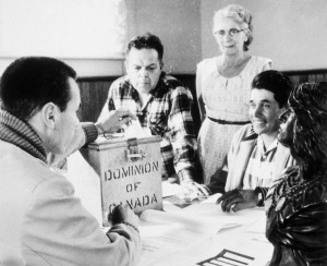 Status Indians were able to vote for the first time in 1960. Lawrence Salleby, Chief Ralph Loucks, Lucy Musgrove, and Eldon Muscrat at the ballotbox in the Hiawatha Council Hall, October 1960. (Nick Nickels. Library and Archives Canada/PA-123915) http://collectionscanada.gc.ca/pam_archives/index.php?fuseaction=genitem.displayItem&rec_nbr=3364668&lang=eng