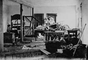 Efforts by the Anglo-Ontarian population in Winnipeg to dominate the Francophone community included an election riot in 1872 that targeted newspapers that were critical of John Schultz — including these printing presses at The Manitoban. (James Penrose. Library and Archives Canada / PA-165779) http://collectionscanada.gc.ca/pam_archives/index.php?fuseaction=genitem.displayItem&rec_nbr=3192361&lang=eng