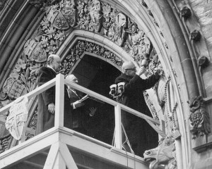 PM St. Laurent begins the process of carving Newfoundland's coat of arms into the arch of the Parliament Buildings in Ottawa. (National Film Board/Library and Archives Canada/C-006255) http://collectionscanada.gc.ca/pam_archives/index.php?fuseaction=genitem.displayItem&rec_nbr=3408567&lang=eng