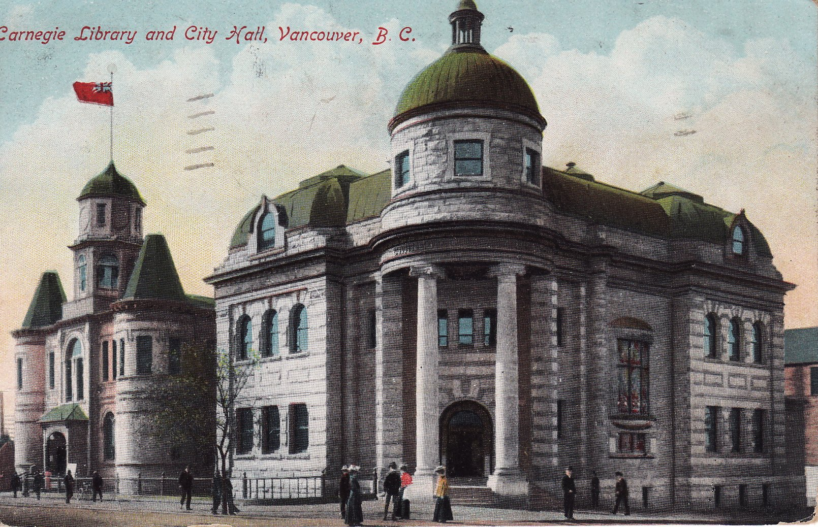 Postcard of two grand stone buildings. One has the Red Ensign flying from the roof.