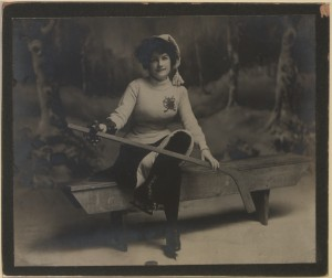 """Benched"" – a collectors' card in the ""Canadian Hockey Girl"" series of 1903. Documents like this one remind us that the past may be a foreign country, but it's not necessarily a dull old place. (Canadian Copyright Collection, Picturing Canada Project, British Library) https://commons.wikimedia.org/w/index.php?title=Category:Images_from_the_Canadian_Copyright_Collection_at_the_British_Library&filefrom=13446%0AThe+Globe+kittens+%28HS85-10-13446-6%29.jpg#/media/File:Benched_The_Canadian_hockey_girl_Series_no_2,_photo_no_2_(HS85-10-15498).jpg"