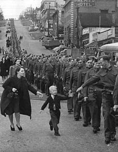 "A British Columbian regiment prepares to depart from New Westminster, 1940. (""Wait for me daddy"" by Claude Dettloff, photographer - City of Vancouver Archives online database, Public Domain, https://commons.wikimedia.org/w/index.php?curid=4210431)"