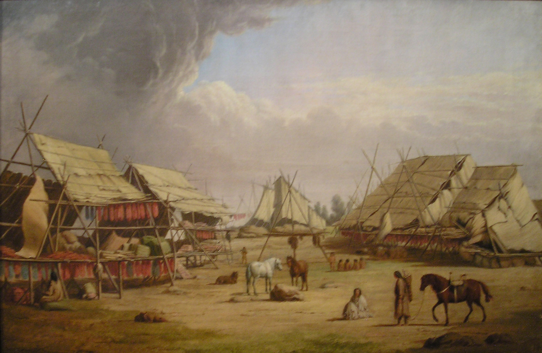 Painting of a village. Houses for drying fish are visible. Horses, dogs, and people stand.