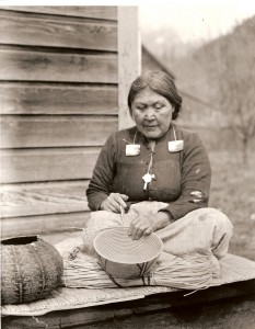 In 1871 the newcomer population in BC was still badly outnumbered by Aboriginal people who were, nevertheless, being hustled onto reserves – and mostly without treaties. A Stó:lō woman, weaving baskets, n.d. (Photo by Royal British Columbia Museum - PN996, Public Domain, https://commons.wikimedia.org/w/index.php?curid=2549274)