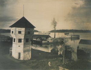 "The HBC bastion overlooking the busy coal harbour at Nanaimo, 1906. (By Howard King - This image is part of the Canadian Copyright Collection held by the British Library, and has been digitised as part of the ""Picturing Canada"" project.It was deposited with copyright number 18676, and is indexed with Dalhousie number 717.English 