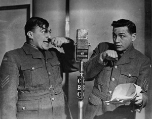 Radio comedians Johnny Wayne and Frank Shuster (aka: Wayne & Shuster) take on Hitler, ca. 1944. (Canada. Dept. of National Defence / Library and Archives Canada / PA-152119)