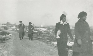 Figure 6.7 Women from Africville walk towards Halifax on Campbell Road, days after the explosion of the SS Mont Blanc in Halifax harbour on 6 December 1917. The ship was carrying munitions when it was struck at low speed by another vessel, caught fire, and produced the largest pre-nuclear explosion on record, killing 2,000 and injuring 10,000 more. Photo by James & Son, Nova Scotia Archives. https://www.flickr.com/photos/nsarchives/15318268313/in/album-72157649578567872/