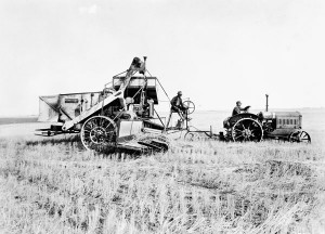 Combined harvester-threshers reduced the need for itinerant threshing crews and they pitched farmers into debt, both on the eve of the Depression. High Prairie, Alberta, 1930. Credit: Library and Archives Canada/PA-040497