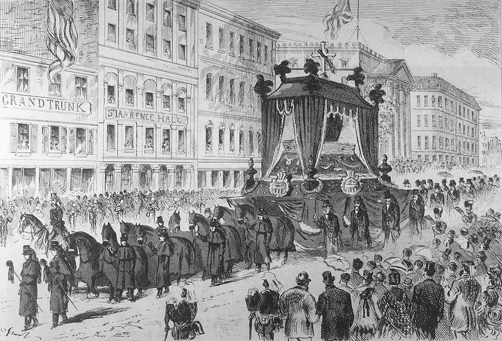 A Sketch. A team of horses pulls a coffin decorated with drapery. A large procession follows.