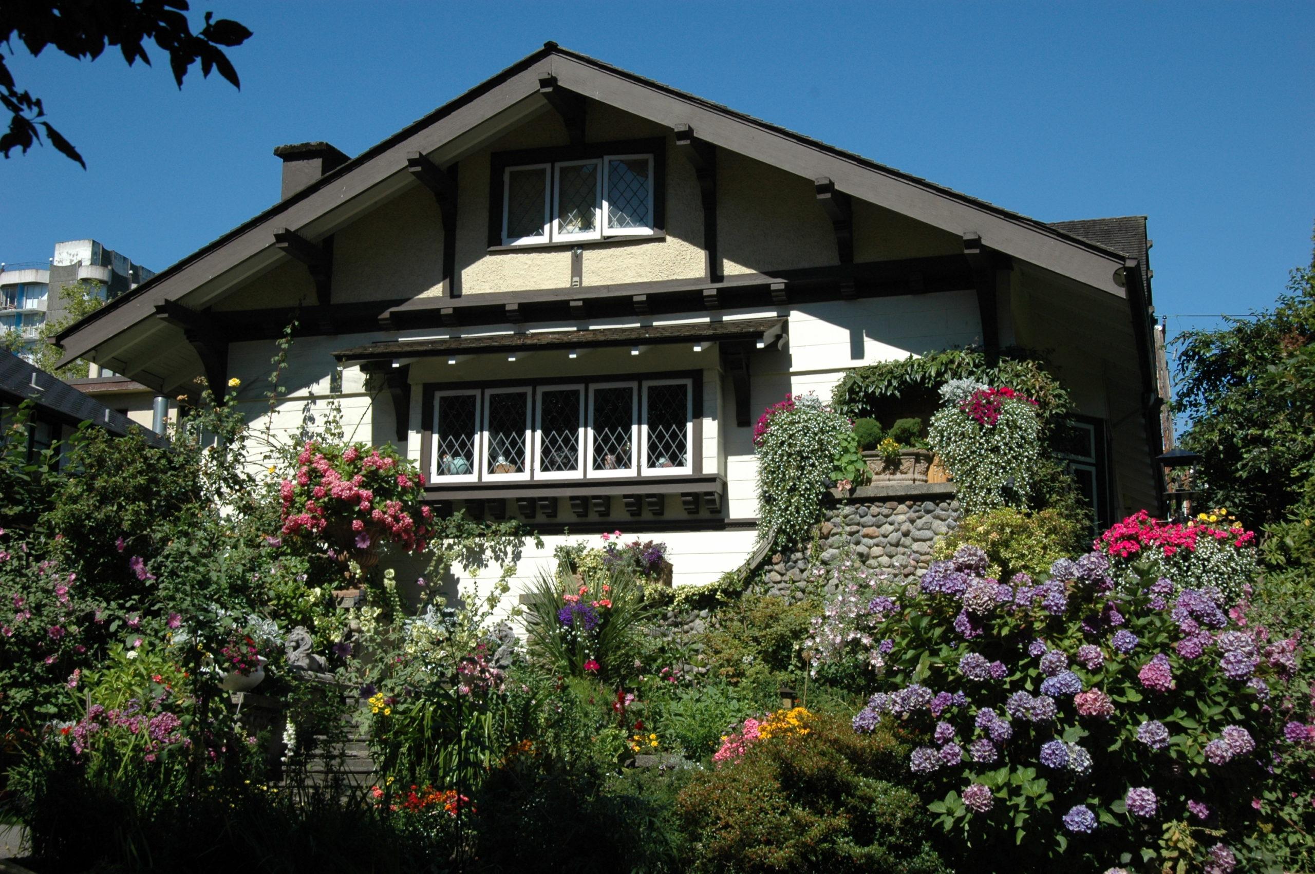 Tudor-style house with a flower garden.