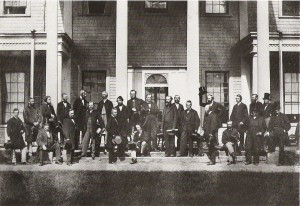 A large group of men wearing suits pose for a picture.