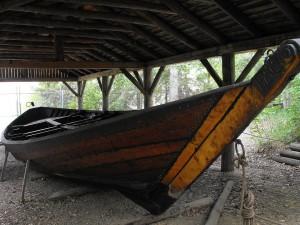 A large, canoe-like boat with gradually sloping sides.