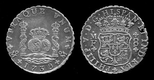 Silver coins with rough edges. Both contain images of a crown.