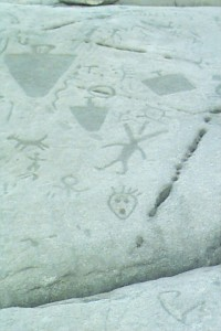 Numerous simple drawings on a rock's surface