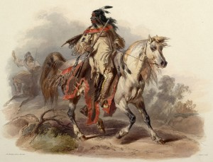 A Blackfoot warrior carrying a spear rides a white horse.