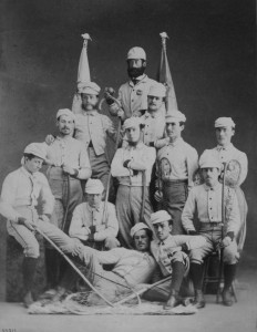 Men pose for a picture in their lacrosse uniforms.