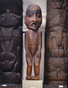 A large carved wooden figure with an opening for its mouth.