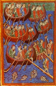 Six rowboats with men holding shields and spears row across the water.