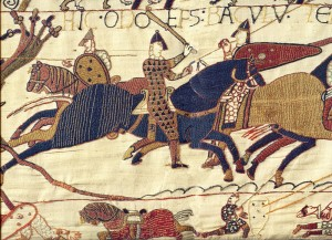 A tapestry of soldiers fighting on horseback.