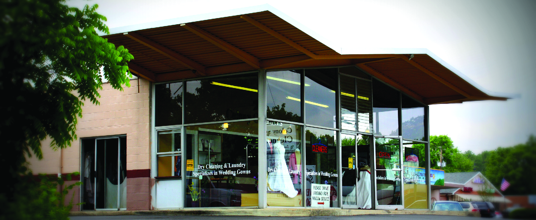 Exterior photograph of dry-cleaning business.
