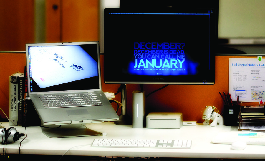 Photo of a laptop and separate monitor on a desk.
