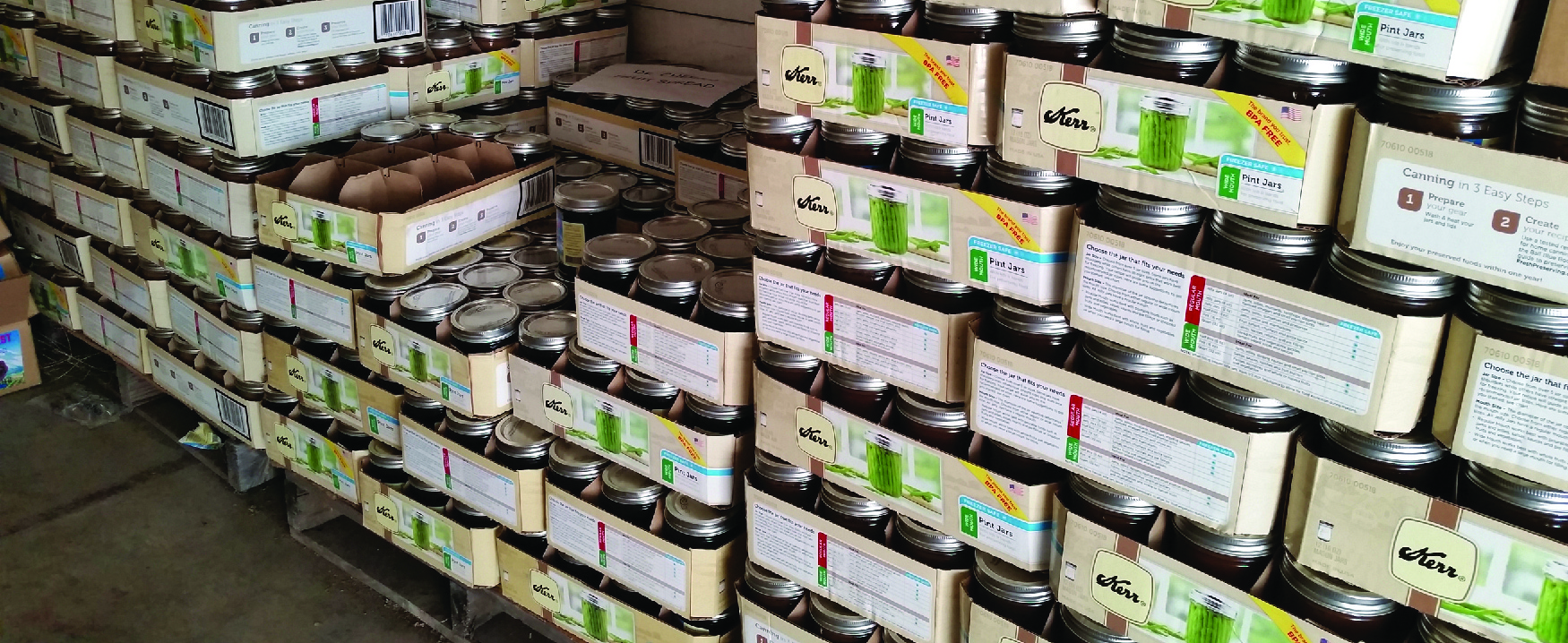 A photograph shows boxes of canning jars.