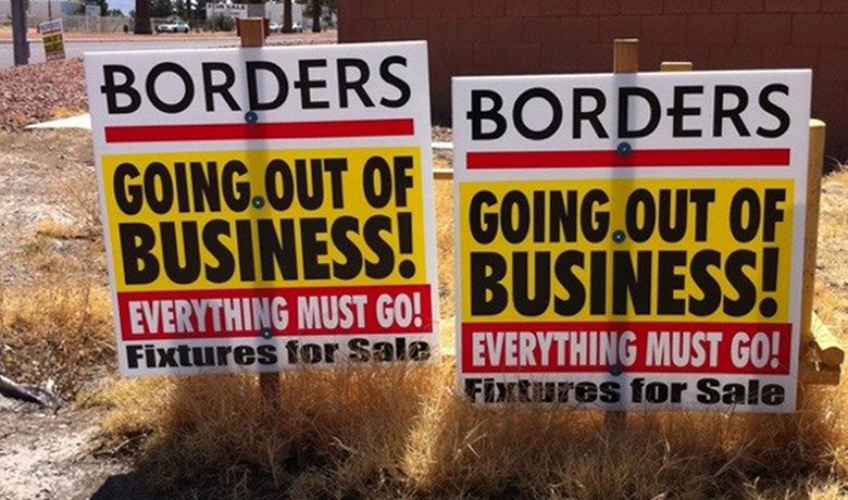 """This image is a photograph of a """"Going Out of Business"""" signs for Borders. The signs denote that even the fixtures are for sale."""
