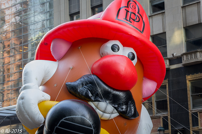 A photo shows a Mr. Potato Head balloon floating at the Thanksgiving Day parade in New York City.