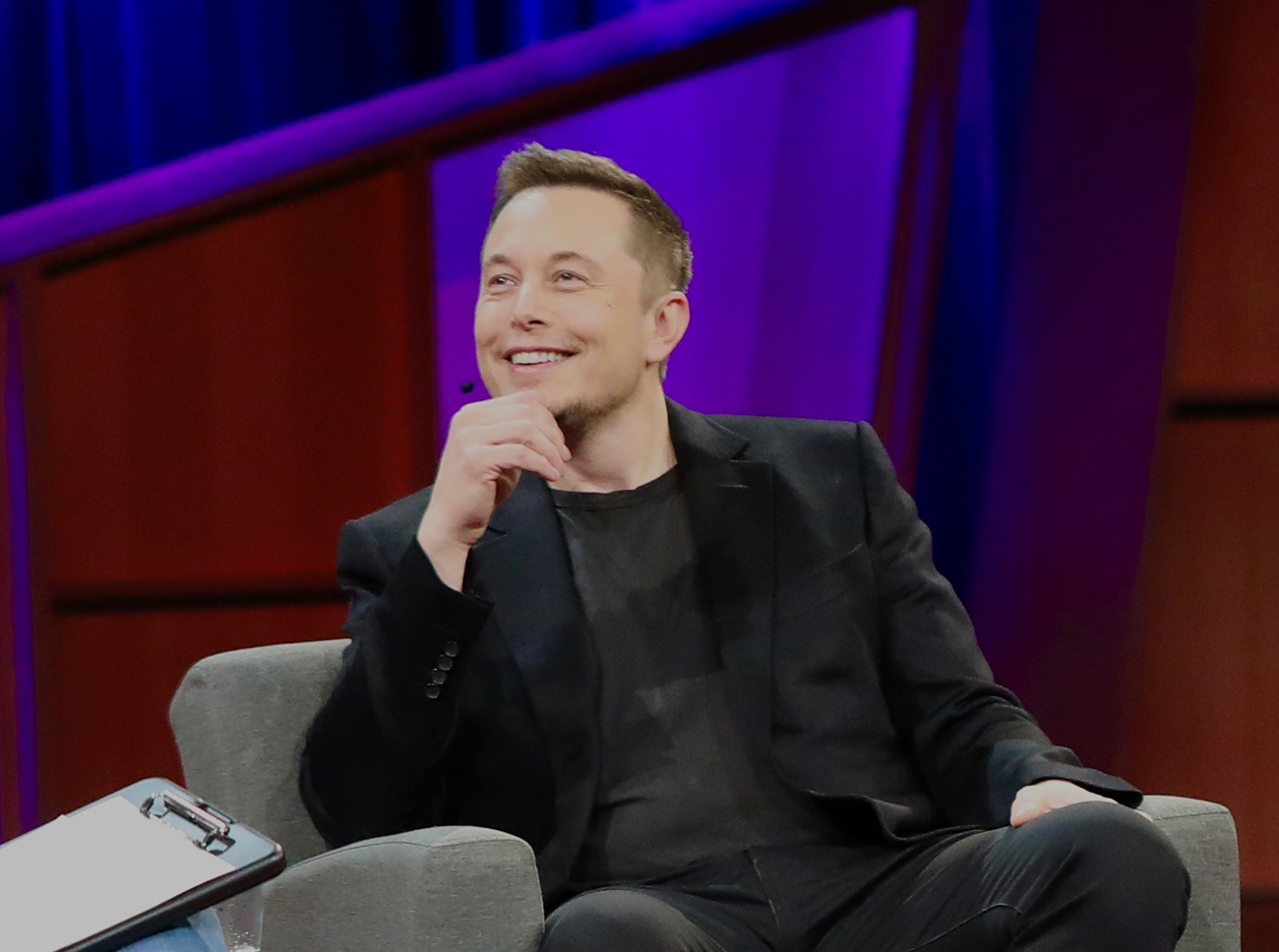 A photograph shows Elon Musk