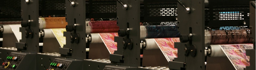 Printing press producing colourful prints.