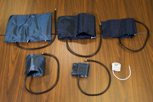 Varying blood pressure cuff sizes ranging from large thigh cuffs to small neonatal cuffs