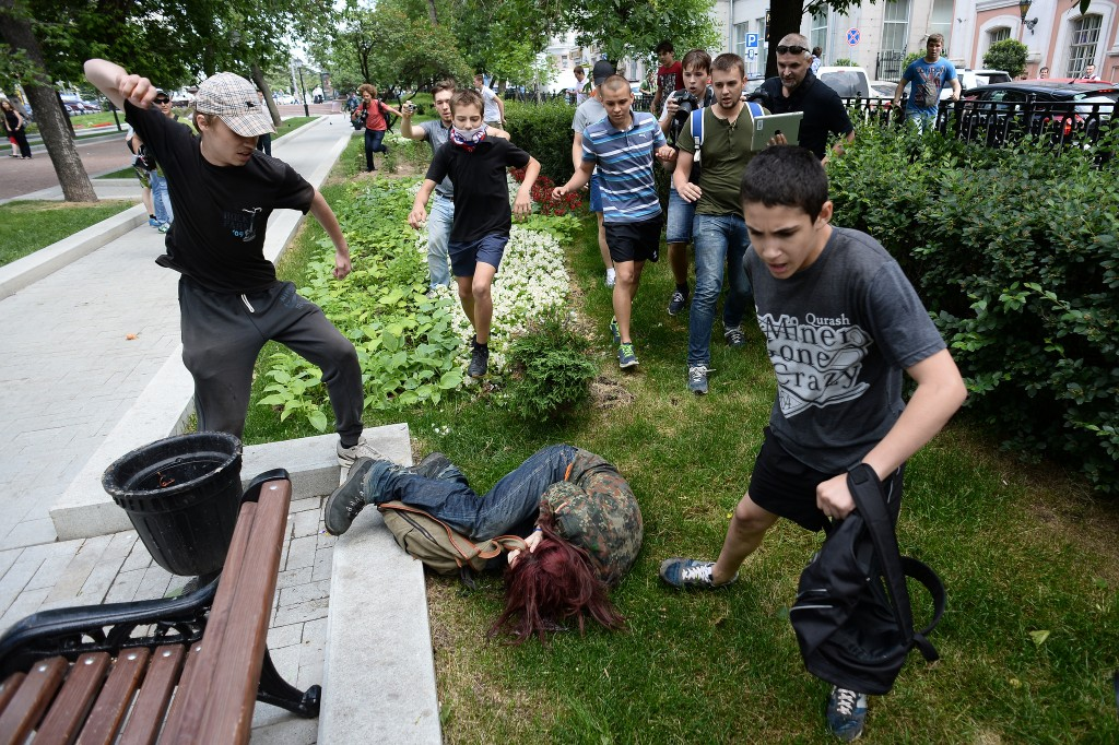 "LGBT activists are attacked during an action ""Day of Kisses"" against a homophobic bill in Moscow"