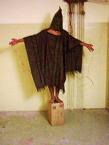 Figure 6. 11 Source: Abu Ghraib Abuse standing on box (http://en.wikipedia.org/wiki/File:AbuGhraibAbuse-standing-on-box.jpg) is in the public domain (http://en.wikipedia.org/wiki/Public_domain)