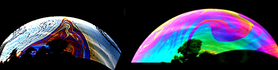 A photograph of two bubbles is shown. The bubbles have vivid colors spanning from pink to dark blue and varying across the surface.