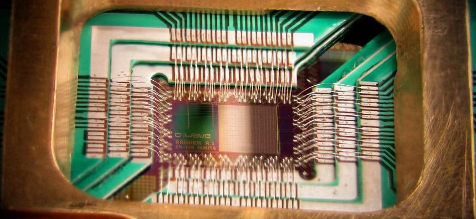 A photograph of a D wave qubit processor