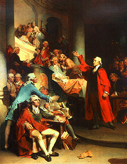 A painting shows Patrick Henry making a speech to a room full of well-dressed colonists. As Henry gestures dramatically with his arm, the members of his audience look on and whisper to one another.