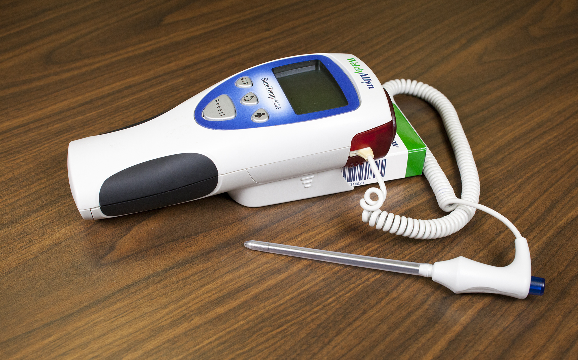 Rectal thermometer that shows the red end on the device with the probe cover on.