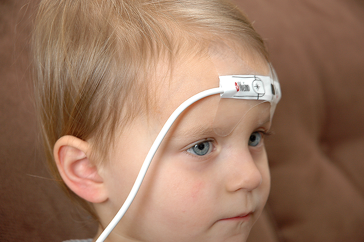 Pulse oximeter with sensor taped across forehead
