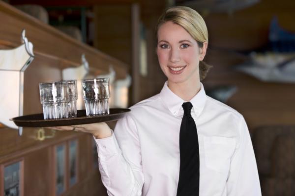 Woman server smiling.